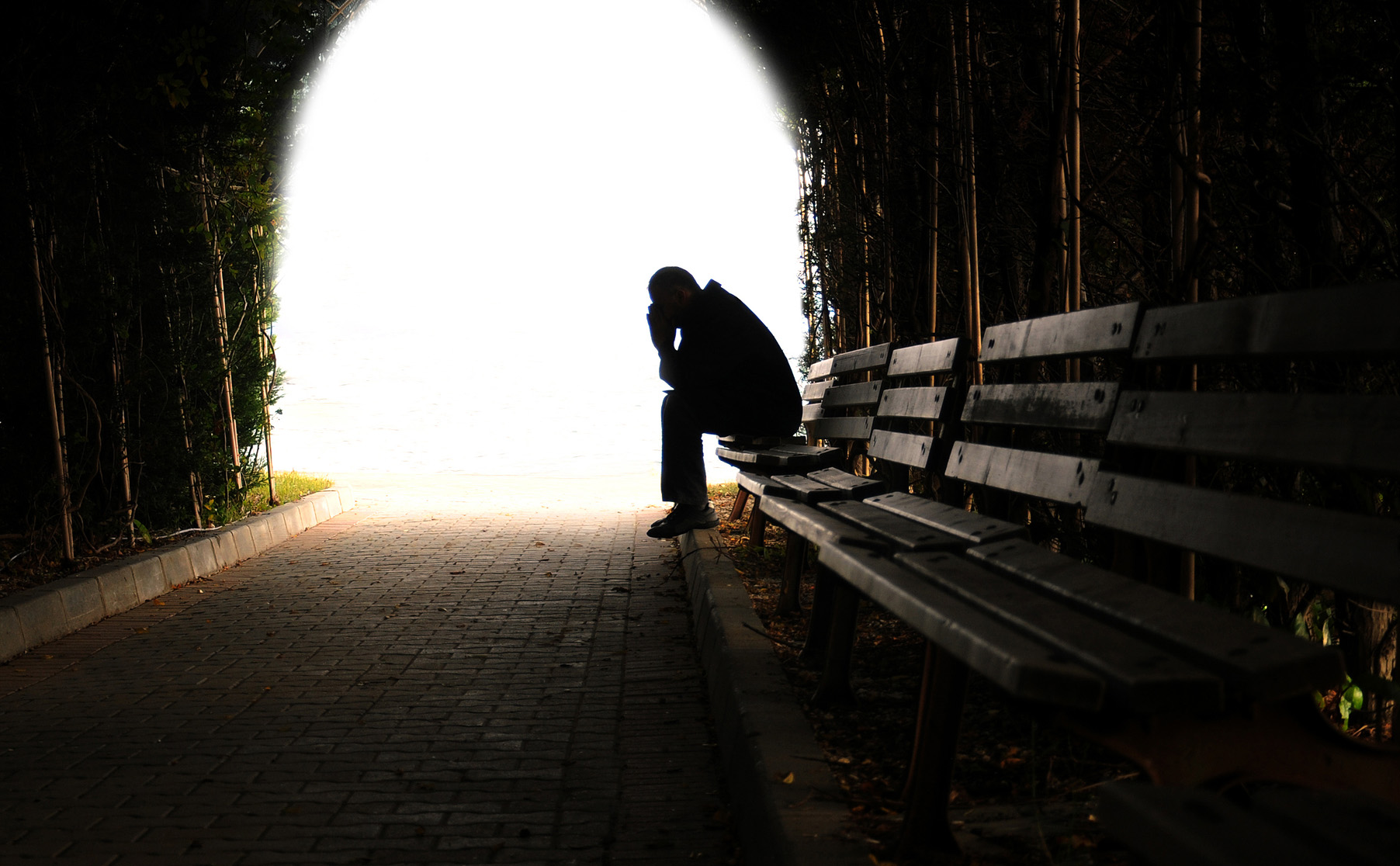Image result for depressed man sitting on bench